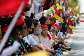 Myanmar citizens living in Thailand protest against the military coup in their country in front of the UN office in Bangkok, Thailand on March 7, 2021 [Reuters/Soe Zeya Tun]