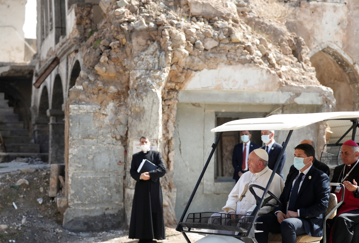 The pope holds a minute of silence at the destroyed cathedral in Mosul's old city. [Yara Nardi/Reuters]