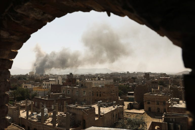 Smoke rises after Saudi-led air raid on an army base in Sanaa on March 7, 2021 [Khaled Abdullah/Reuters]