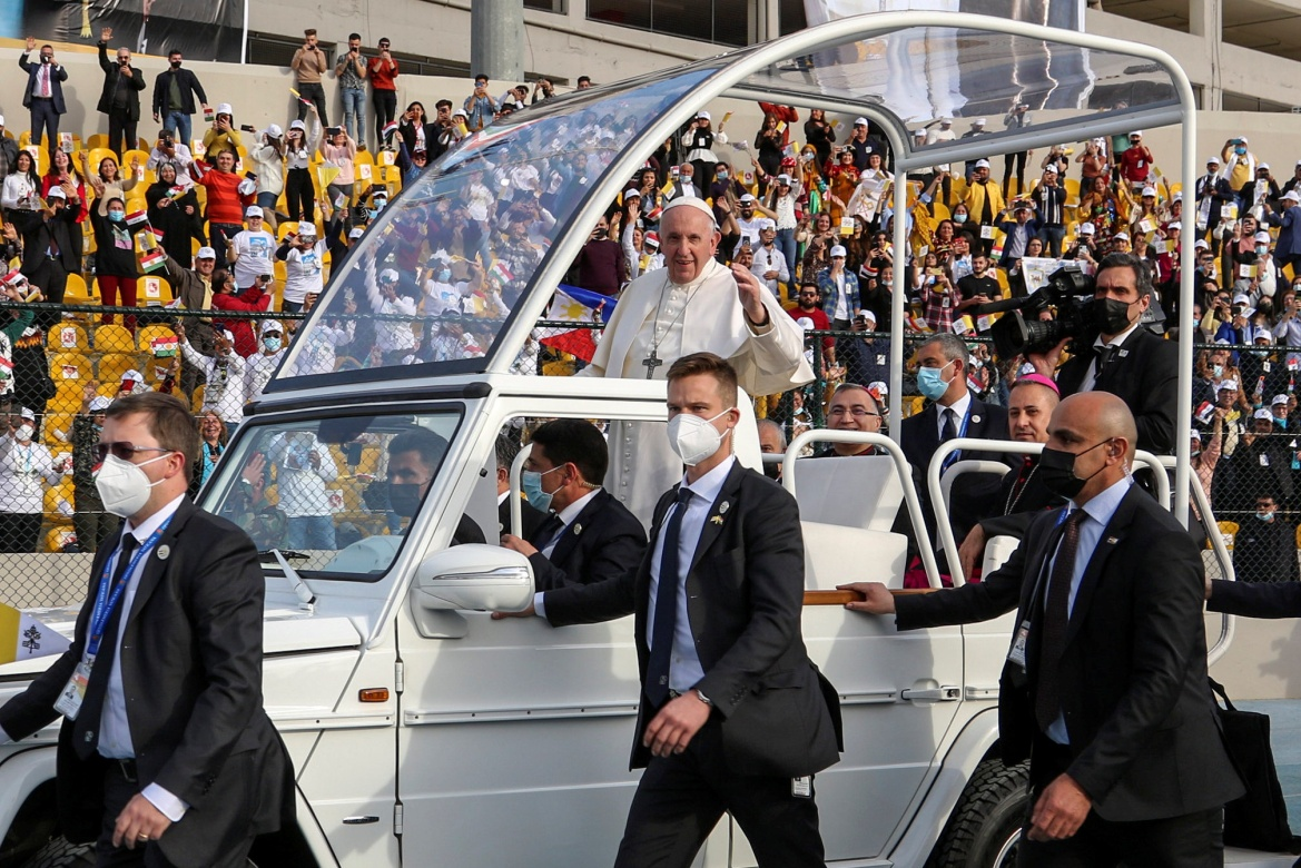 Pope Francis blessing people as he arrives in the popemobile vehicle at the Franso Hariri Stadium [Azad Lashkari/Reuters]