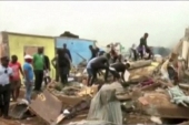 People search through rubble following explosions at a military base in Bata [TVGE/Reuters TV via Reuters]