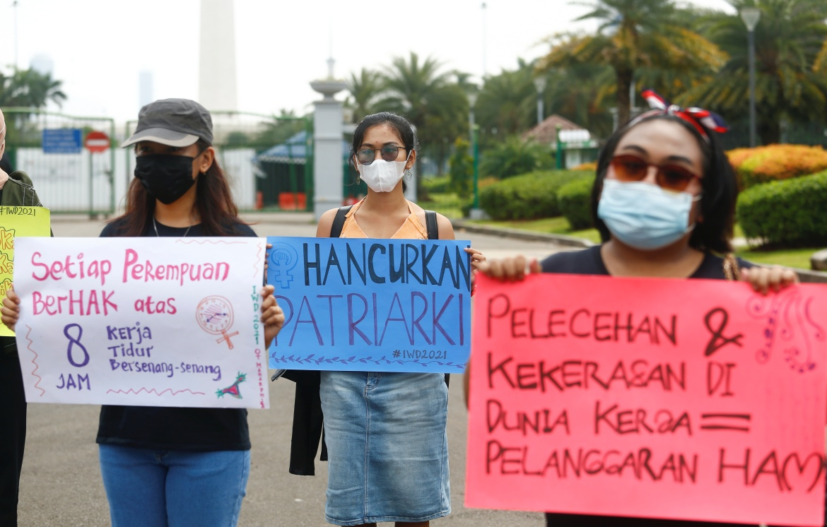 Women take part in a protest during the International Women's Day in Jakarta, Indonesia. [Ajeng Dinar Ulfiana/Reuters]