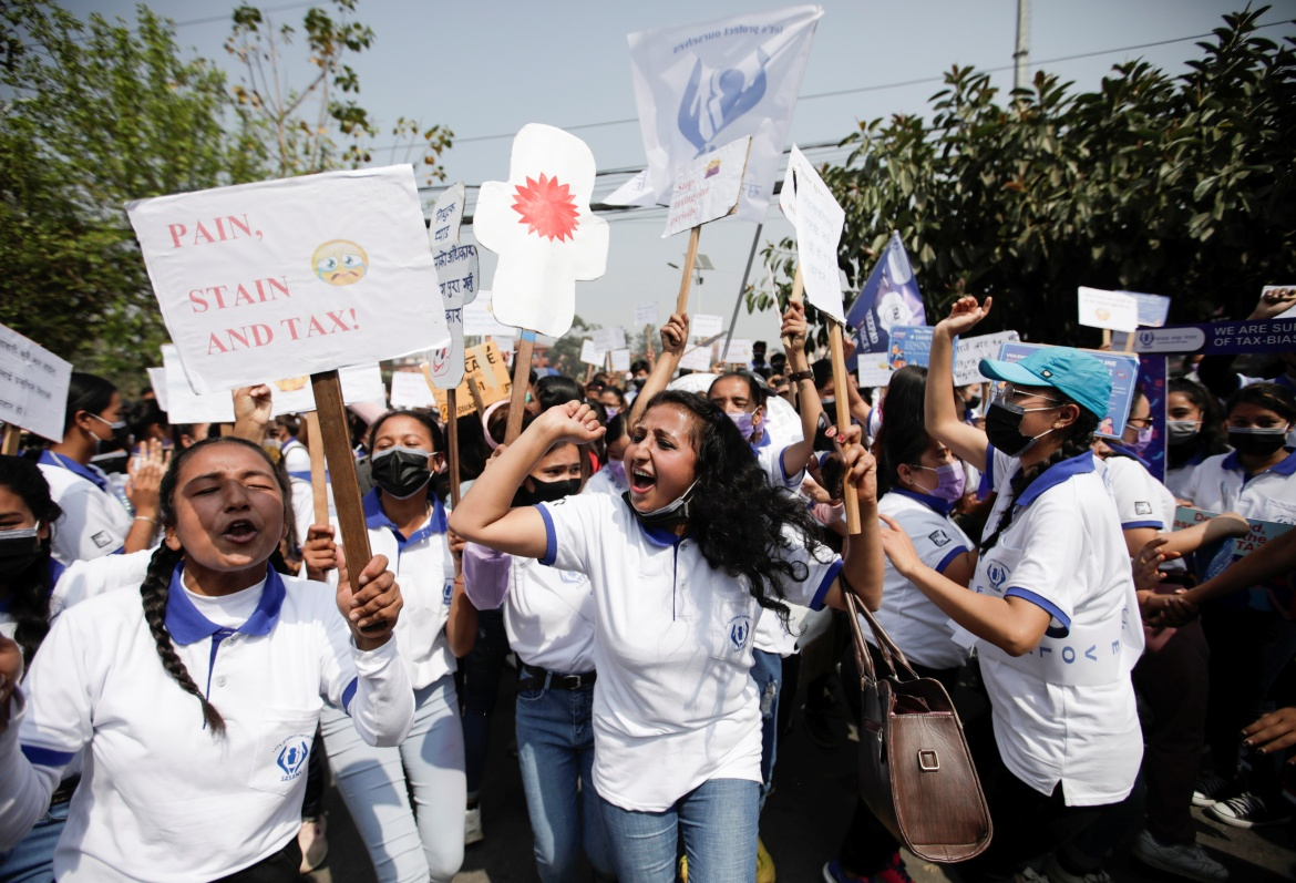 Women take part in a rally demanding tax-free sanitary products during the International Women's Day in Kathmandu, Nepal. [Navesh Chitrakar/Reuters]