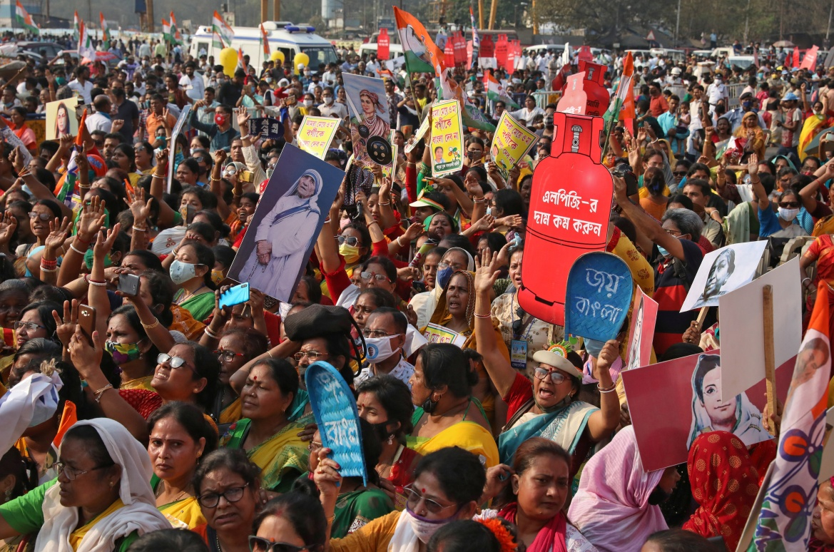 Women shout slogans during a protest against the rise in fuel prices on the occasion of International Women's Day in Kolkata, India. [Rupak De Chowdhuri/Reuters]