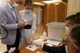 Bashar al-Assad and his wife Asma cast their vote inside a Damascus polling station during a parliamentary election in July [File: Reuters]