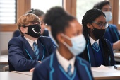 Pupils at England's secondary schools are being mass-tested for COVID and are required to wear face coverings in classrooms [Toby Melville/Reuters]