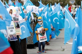 Ethnic Uighur demonstrators wave East Turkestan flags during a gathering on the occasion of International Women's Day to protest China's treatment of Uighurs, in Istanbul, Turkey March 8, 2021 [Murad Sezer/ Reuters]