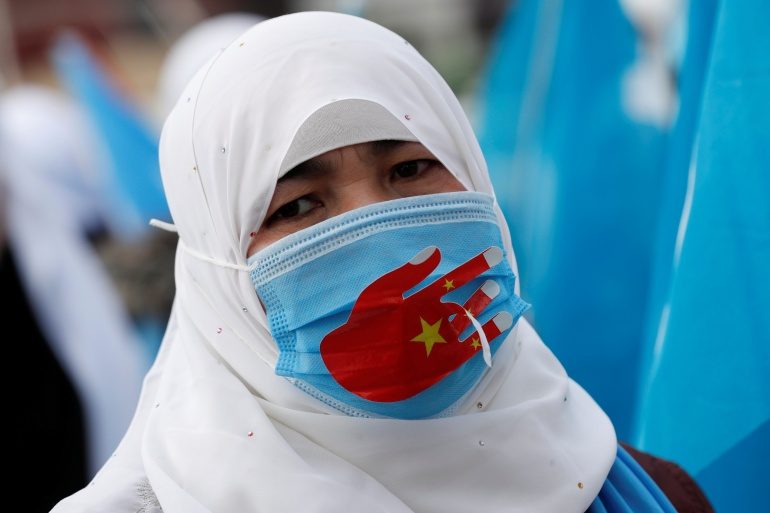 A Uighur demonstrator takes part in a gathering on the occasion of International Women's Day to protest China's treatment of Uighurs, in Istanbul, Turkey March 8, 2021 [Murad Sezer/ Turkey]