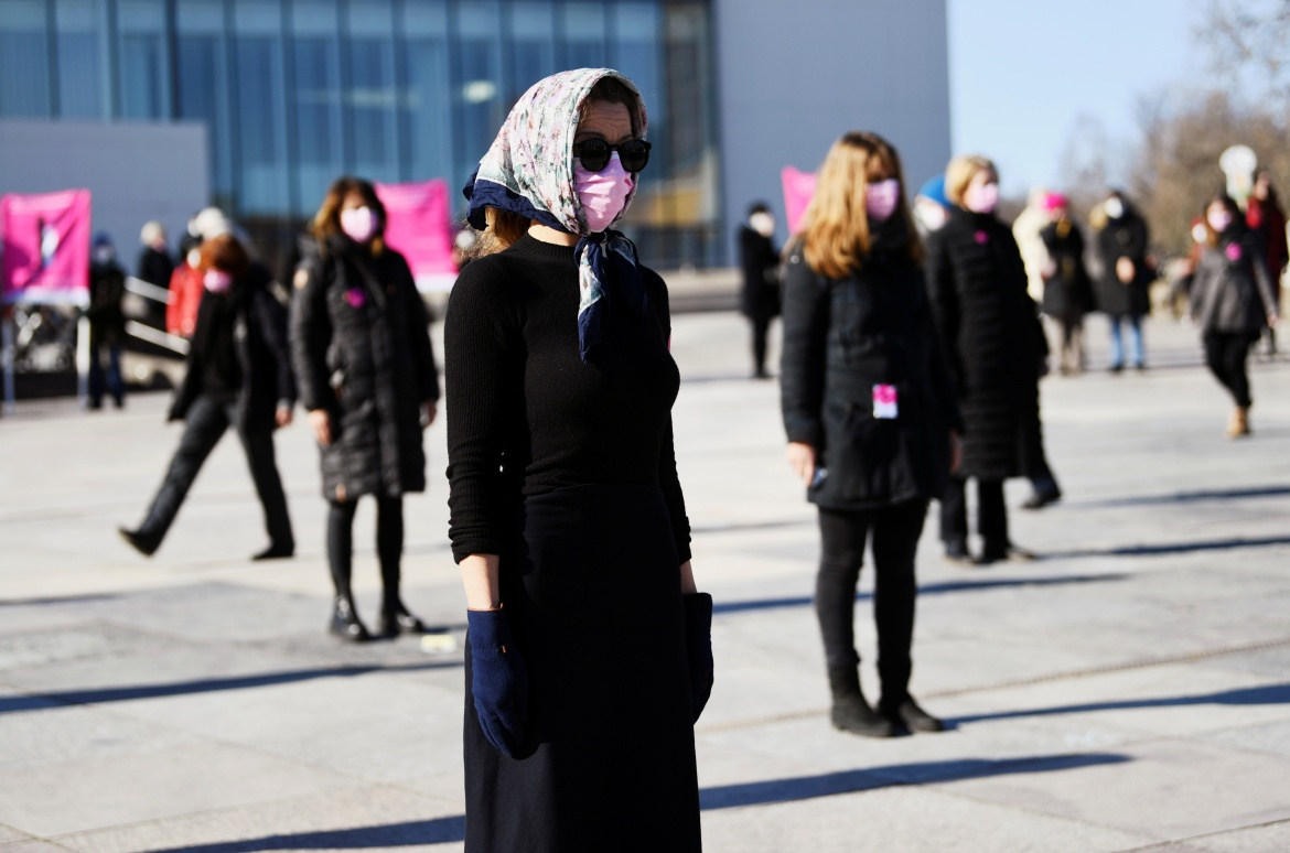 People attend a demonstration to mark International Women's Day, amid the coronavirus pandemic in Berlin, Germany. [Annegret Hilse/Reuters]