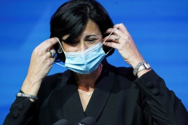 Dr Rochelle Walensky, President Joe Biden's appointee to run the CDC, removes her mask to speak as Biden announces nominees and appointees to serve on his health and coronavirus response teams during a news conference at his transition headquarters in Wilmington, Delaware on December 8, 2020 [File: Kevin Lamarque/Reuters]
