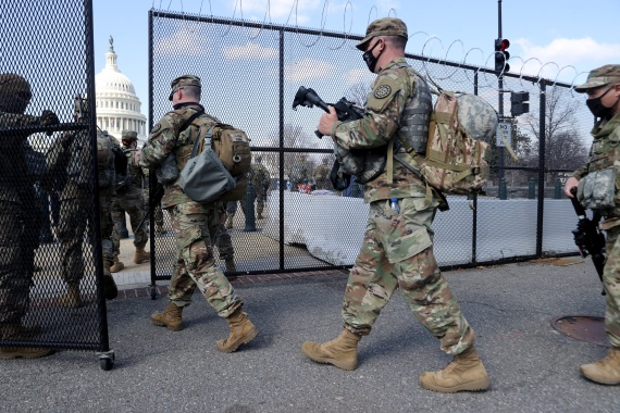 National Guard soldiers patrol the grounds of the US Capitol after police warned that a militia group might try to attack the Capitol complex on March 4, 2021 [File: Jonathan Ernst/Reuters]