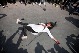 A woman performs an act to highlight growing incidents of violence during International Women's Day in Kathmandu, Nepal [File: Navesh Chitrakar/Reuters]