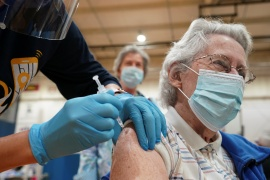 Mary Lou Russler receives a COVID-19 vaccine during a community vaccination event in Martinsburg, West Virginia, on March 11, 2021 [Kevin Lamarque/Reuters]