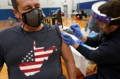 The US has a vaccination rate of 61.6 doses administered per 100 people [File: Reuters]