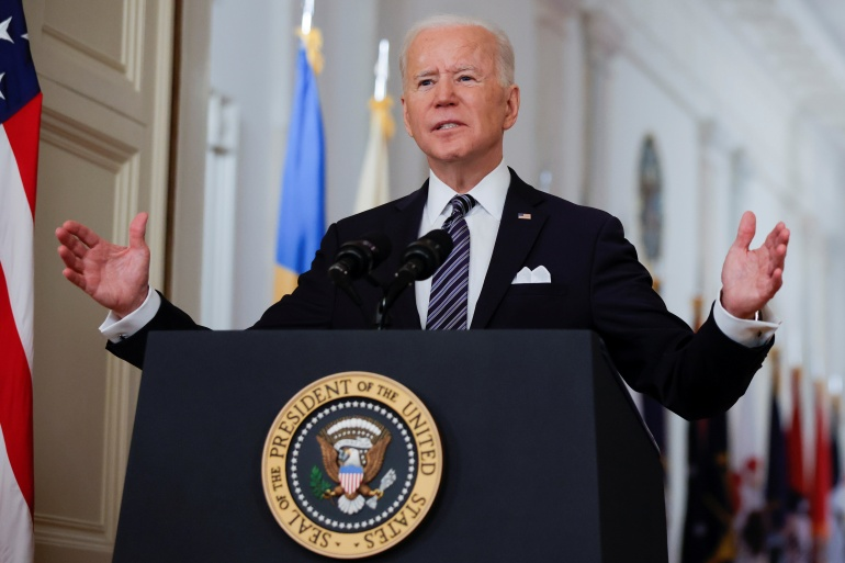 US President Joe Biden told Americans that he was speeding up the country's vaccination programme and hoped there would be some semblance of normality by July 4 [Tom Brenner/Reuters}