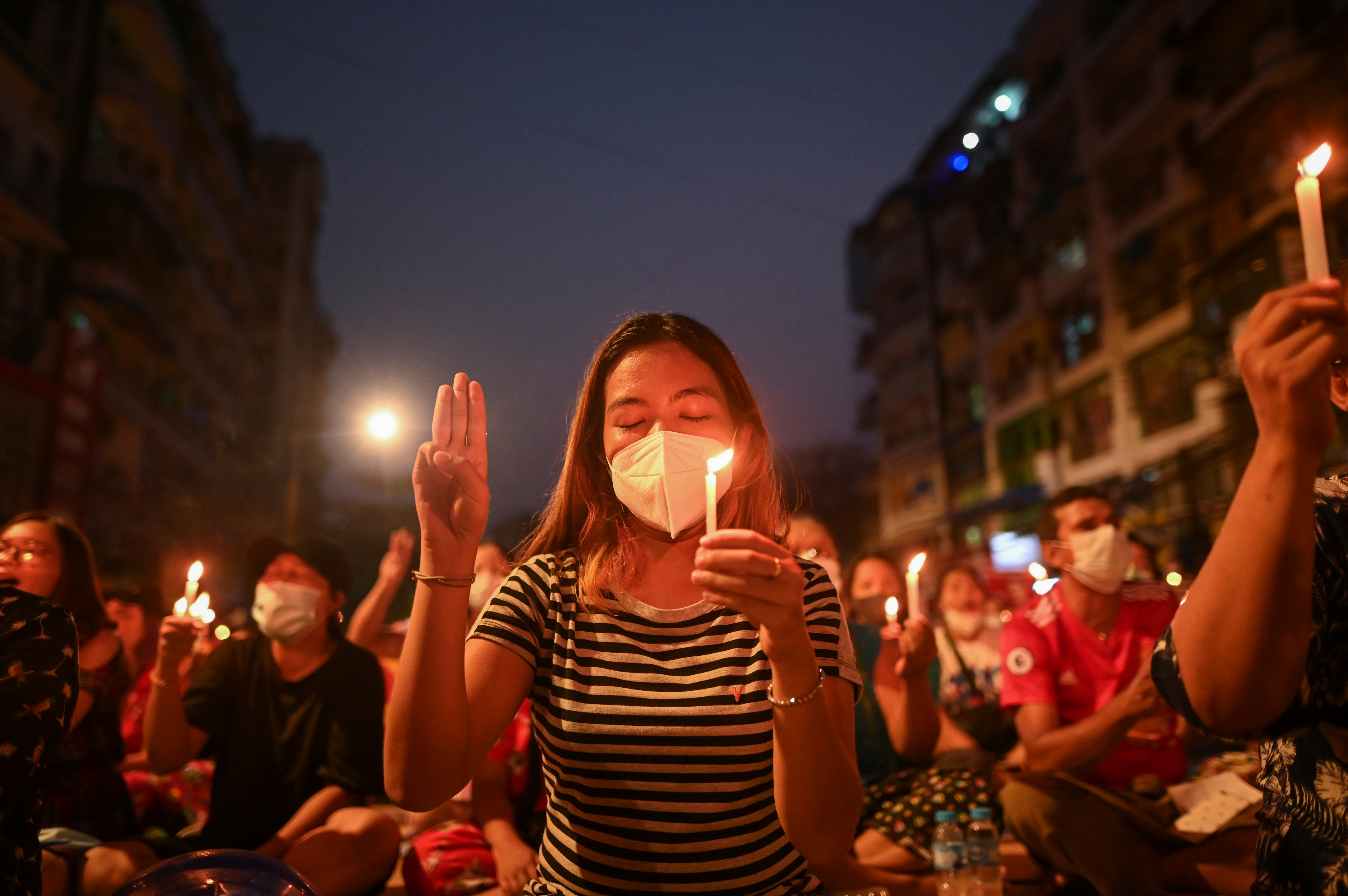 With the death toll increasing protesters have begun to hold candlelit vigils