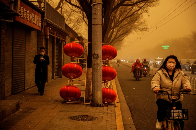 The sandstorms turned the sky an eerie yellow and sent pollution soaring in the Chinese capital [Thomas Peter/REUTERS]