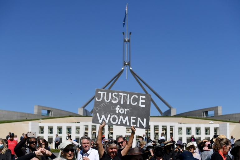 Protesters gathered outside parliament in Canberra and towns and cities across Australia to demand justice for women [Mick Tsikas/AAP Image via Reuters]