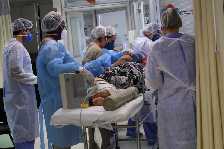 A COVID-19 patient is transferred to the intensive care unit of Hospital Sao Paulo in Sao Paulo, Brazil, March 17, 2021 [File: Amanda Perobelli/Reuters]