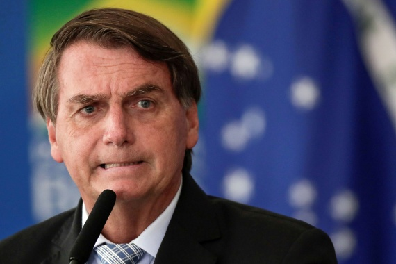 Brazilian President Jair Bolsonaro has been dismissive of the coronavirus pandemic and vaccines but faces growing pressure with numbers of infections and deaths reaching record highs in Brazil [File: Ueslei Marcelino/Reuters]