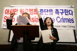 Michelle Kang, the vice president of external affairs of Korean American Chamber of Commerce Atlanta, chants 'we demand' as she raises her fist during a meeting with members of the Atlanta Korean American Committee against Asian Hate Crime after the fatal shooting at three Georgia spas [Dustin Chambers/Reuters]