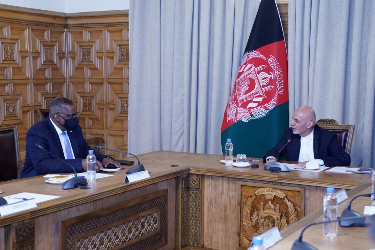 Afghanistan's President Ashraf Ghani, right, meets US Secretary of Defense Lloyd Austin, in Kabul, Afghanistan [Presidential Palace/Handout via Reuters]