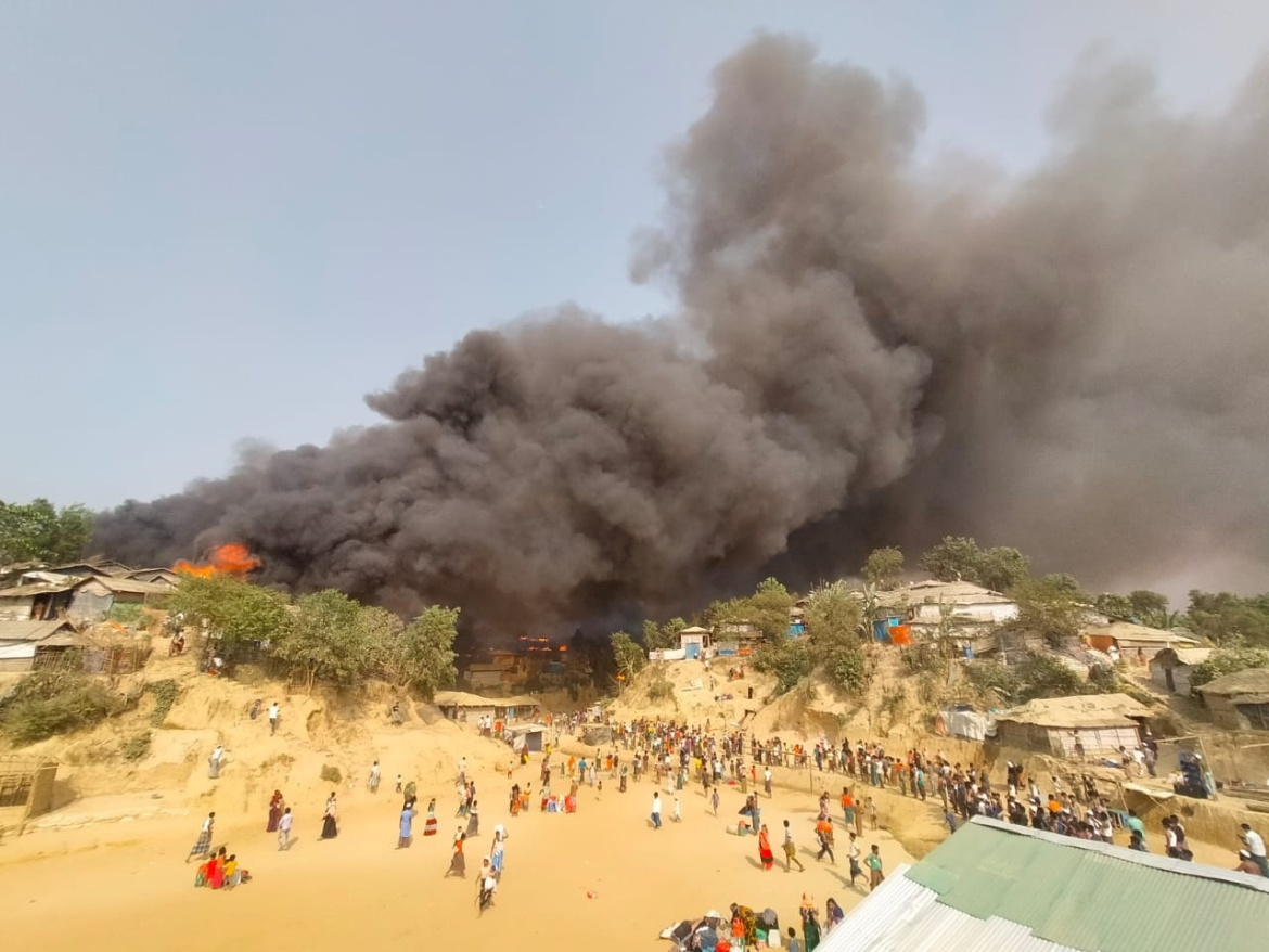 Fire rips through Balukhali refugee camp in Cox's Bazar. Bangladesh has sheltered more than a million Rohingya, the vast majority of them having fled Myanmar in 2017 in a major crackdown by Myanmar's military. [Rohingya Right Team/Md Arakani via Reuters]