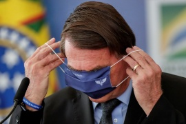 Brazil's President Jair Bolsonaro has faced widespread criticism for his government's handling of the COVID-19 pandemic amid a surge in infections and deaths [Ueslei Marcelino/Reuters]