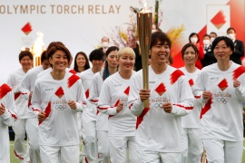 Some 10,000 runners will now carry the flame across Japan's 47 prefectures over the next 121 days [Kim Kyung-Hoon/Pool via Reuters]