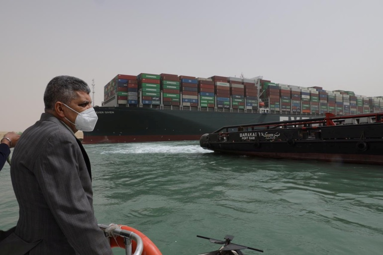 Osama Rabie, chairman of the Suez Canal Authority, monitors the situation near stranded container ship Ever Given, one of the world's largest container ships, after it ran aground, in Suez Canal, Egypt, March 25, 2021 [Suez Canal Authority/Handout/Reuters]