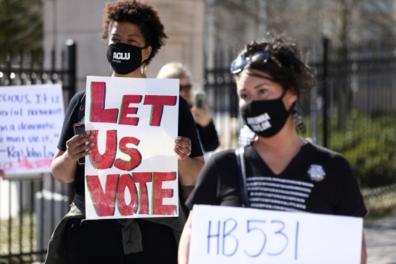 Protesters gather outside of the Georgia State Capitol to protest new legislations that would place tougher restrictions on voting in Georgia, in Atlanta, March 4, 2021 [Dustin Chambers/Reuters]