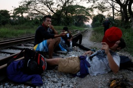 Central American migrants resting along the railway track on their way to the United States in Macuspana, Tabasco, Mexico [Carlos Jasso/Reuters]