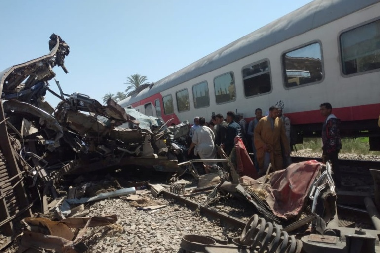 People inspect the damage after two trains collided near the city of Sohag, Egypt [Khaled Hasan/REUTERS]