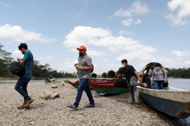 A group of migrants from Honduras arrive in Mexico from Guatemala on their way to the United States in Corozal, Chiapas, Mexico on March 28, 2021 [Carlos Jasso/Reuters]