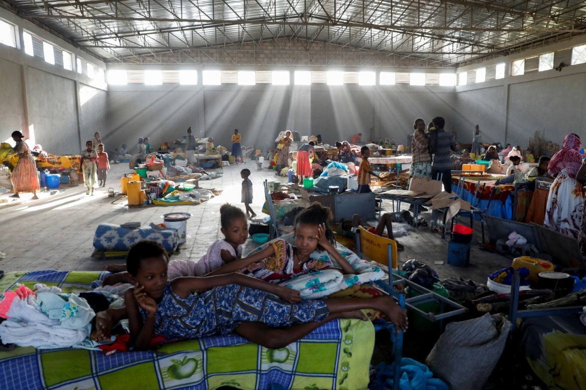 Displaced people at the Shire campus of Aksum University, now a temporary shelter, in the town of Shire. [Baz Ratner/Reuters]