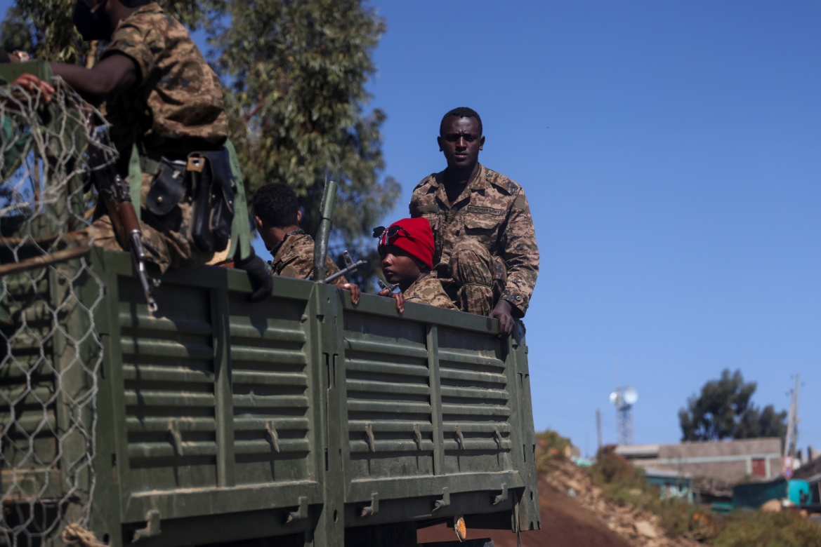 Ethiopian soldiers ride on a truck near the town of Adigrat, Tigray. [Baz Ratner/Reuters]