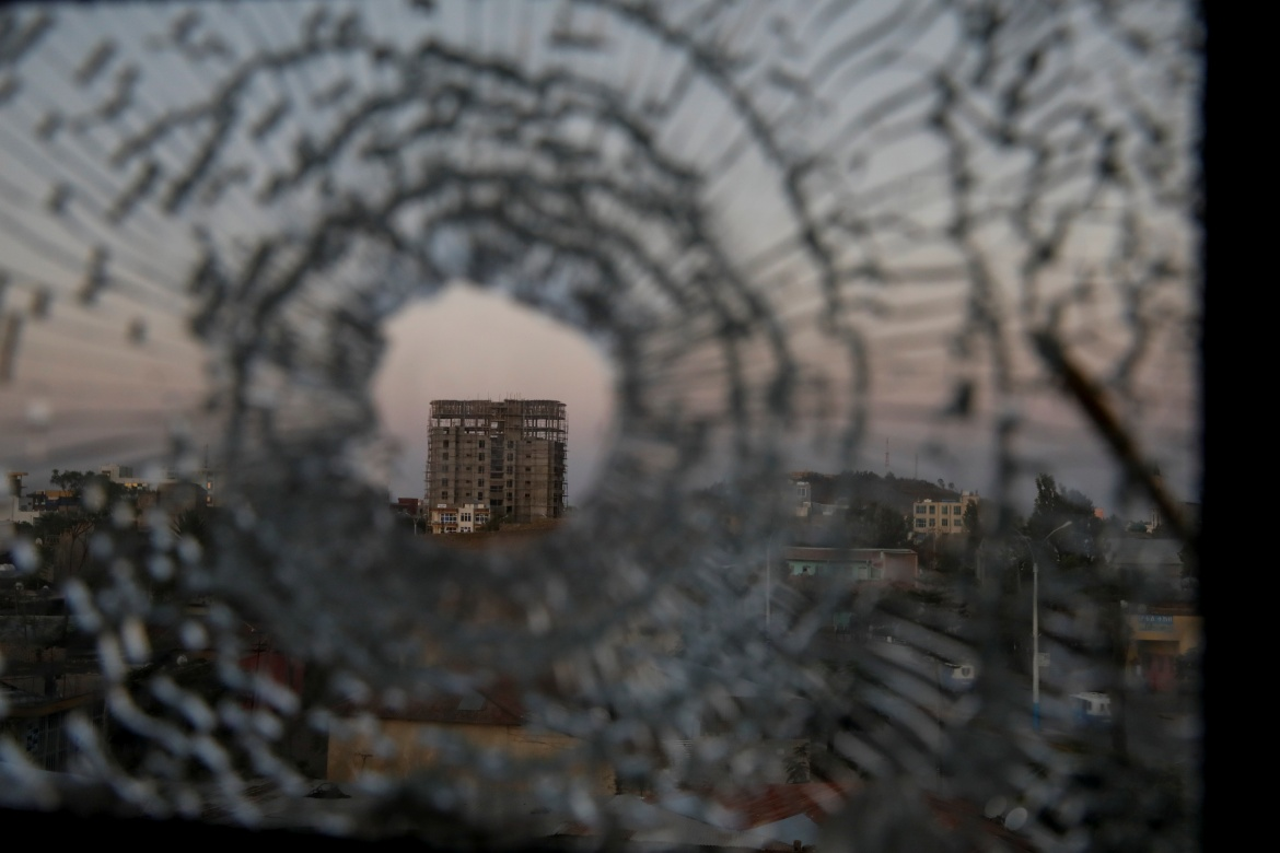 A bullet hole in a window of the Africa Hotel in Shire. Amhara officials say they have taken back a swathe of territory that was historically theirs. [Baz Ratner/Reuters]