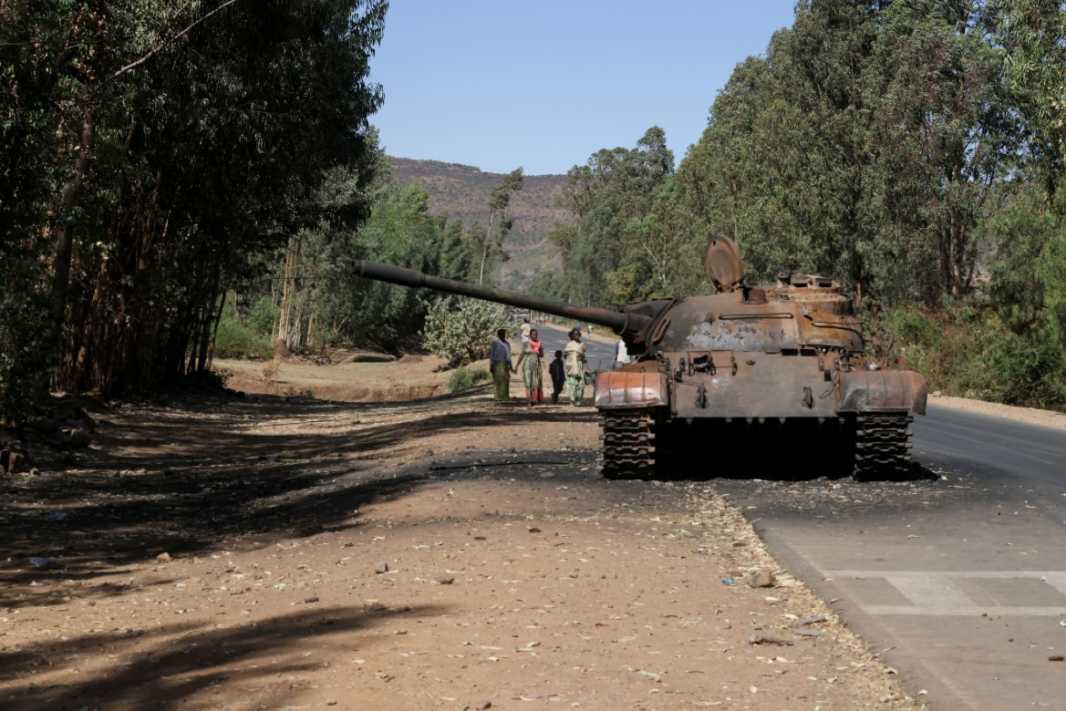 A burned tank stands near the town of Adwa. [Baz Ratner/Reuters]