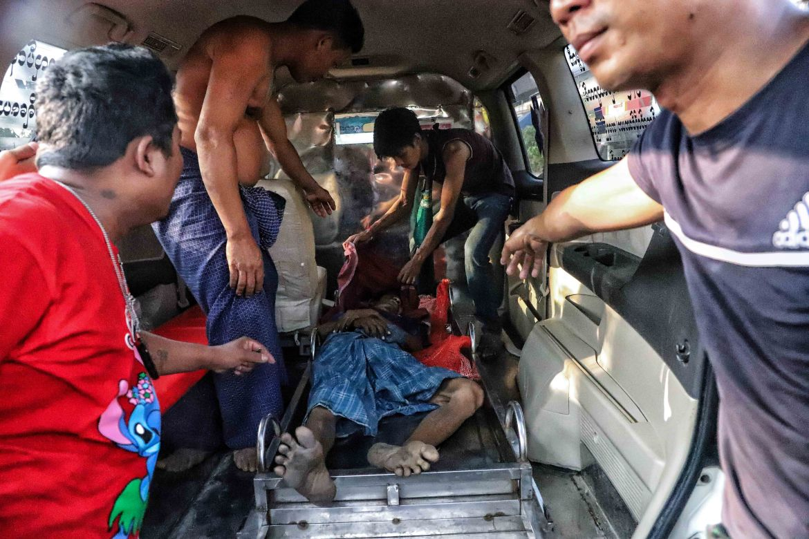 An injured protester is carried into a van as protests against the military coup and detention of elected government members continue in Yangon. [Anadolu]