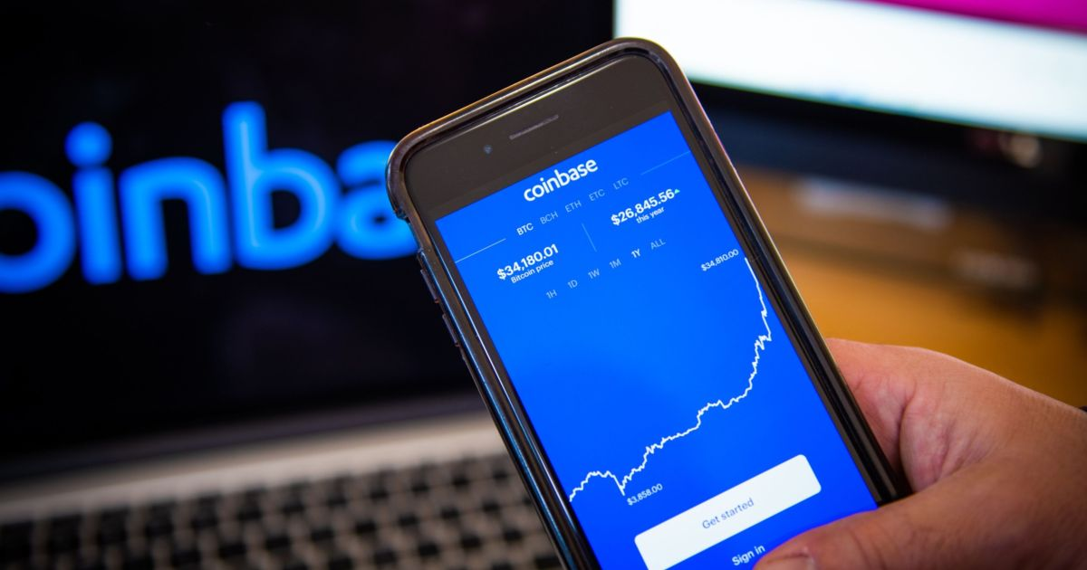 Coinbase hits record low as investors flock to Dogecoin, Binance