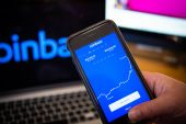 Coinbase's slide comes as investors pour into extremely speculative cryptocurrencies such as Dogecoin and Binance Coin, tokens that the exchange doesn't offer [File: Tiffany Hagler-Geard/Bloomberg]