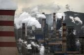 Policymakers could combine techniques such as carbon, capture and storage (CCS) and direct air capture with other measures to help reduce carbon emissions, according to energy consultancy Wood Mackenzie [File: Kevin Frayer/Getty Images via Bloomberg]