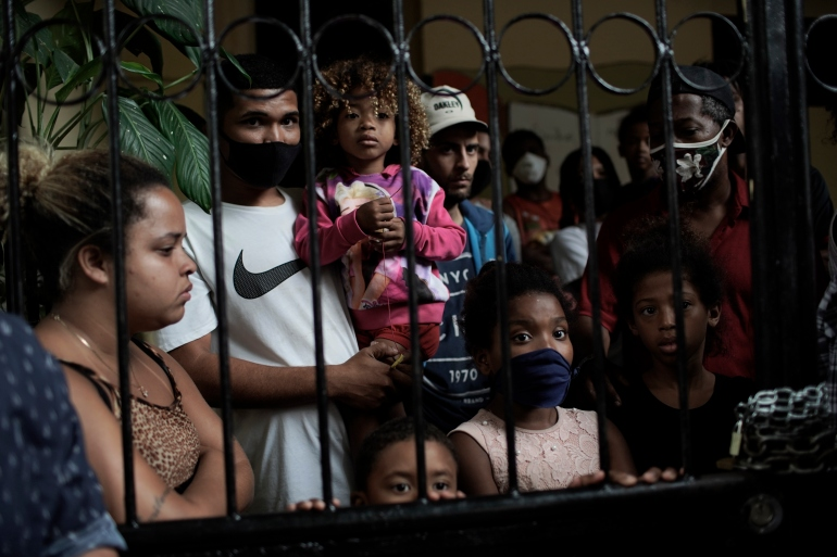 Millions of Brazilians were briefly lifted out of poverty only to be tossed back again as coronavirus pandemic relief aid expired [File: Silvia Izquierdo/AP Photo]