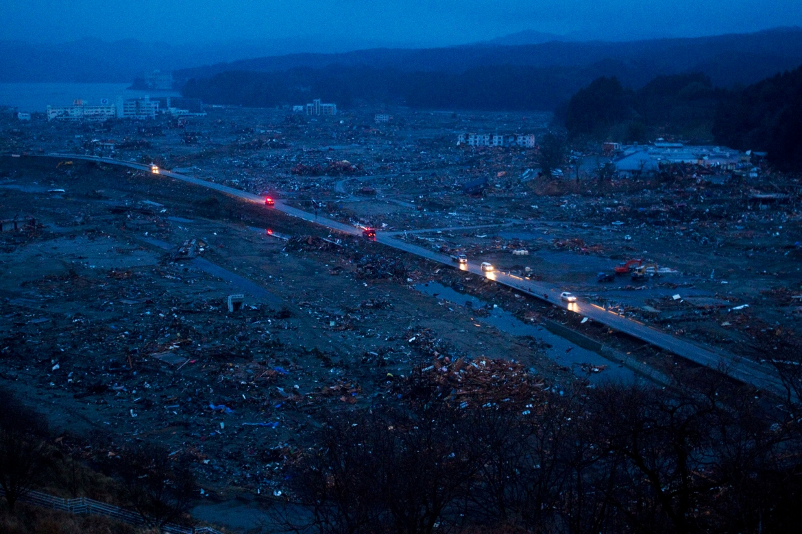 Vehicles pass through the ruins of the levelled city of Minamisanriku, Miyagi Prefecture, northeastern Japan, four days after the tsunami devastated the area in this March 15, 2011, file photo. [David Guttenfelder/AP Photo]