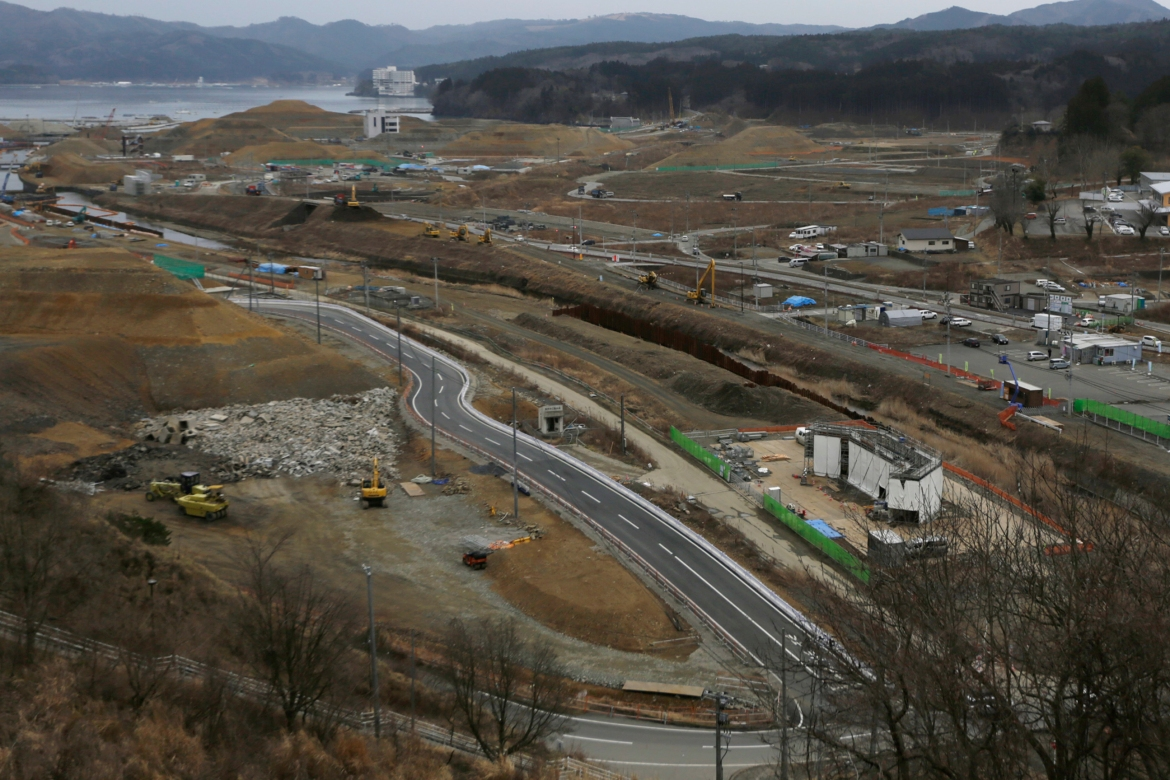 Construction works in the levelled city of Minamisanriku, Miyagi Prefecture, northeastern Japan, almost five years after the tsunami in this March 7, 2016, file photo. [Eugene Hoshiko/AP Photo]