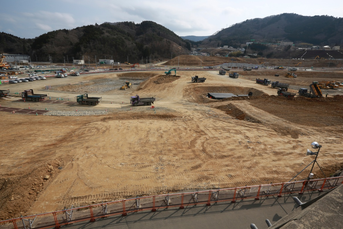 Trucks line up in a queue to dump soils in the tsunami and earthquake-destroyed town of Onagawa, Miyagi Prefecture, northern Japan, in this March 5, 2016, photo. [Eugene Hoshiko/AP Photo]