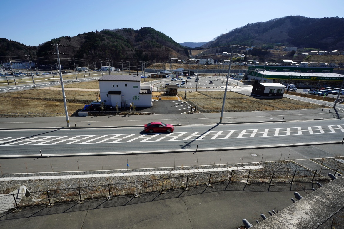 Ten years after the disaster, on March 4, 2021, some new buildings are seen in the tsunami and earthquake-destroyed town of Onagawa, Miyagi Prefecture, northern Japan. [Eugene Hoshiko/AP Photo]