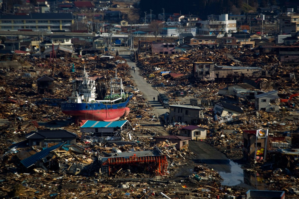 A ship sits in a destroyed residential neighbourhood in Kesennuma, Miyagi Prefecture, northeastern Japan, after a powerful tsunami hit the area in this March 28, 2011, photo. [David Guttenfelder/AP Photo]
