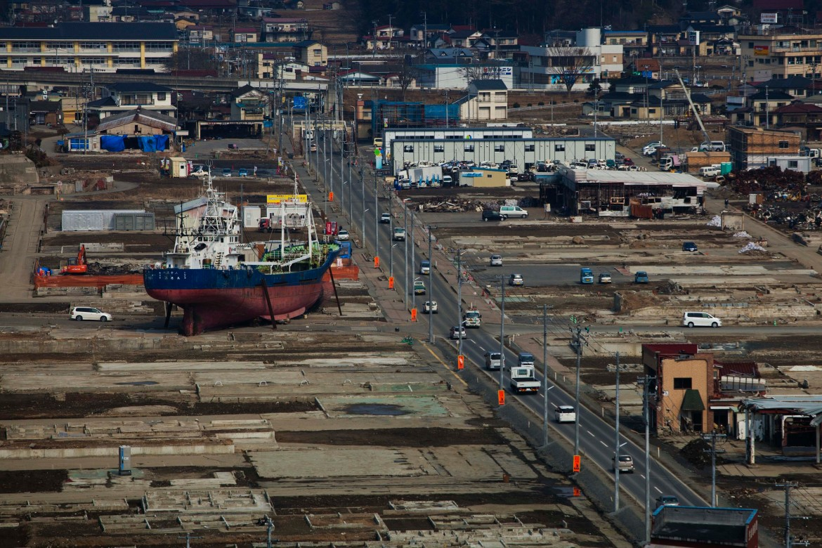 A ship sits in a destroyed residential neighbourhood in Kesennuma, Miyagi Prefecture, northeastern Japan, almost a year after an earthquake and tsunami ravaged the country's coastline in this February 23, 2012, photo. [David Guttenfelder/AP Photo]