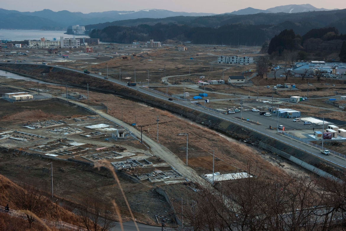Vehicles pass through the ruins of the levelled city of Minamisanriku, Miyagi Prefecture, northern Japan, almost one year after the March 11, 2011 tsunami in this February 23, 2012, photo. [David Guttenfelder/AP Photo]